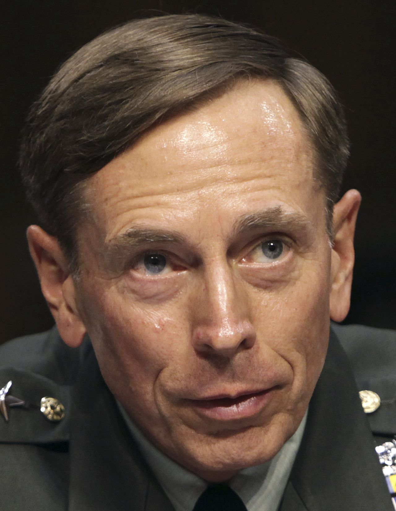 U.S. General David Petraeus gestures during the Senate Intelligence Committee hearing on his nomination to be director of the Central Intelligence Agency on Capitol Hill in Washington in this June 23, 2011 file photo. CIA Director David Petraeus has submitted a letter of resignation to President Barack Obama, Director of National Intelligence James Clapper said on November 9, 2012. REUTERS/Yuri Gripas/Files (UNITED STATES - Tags: POLITICS MILITARY)