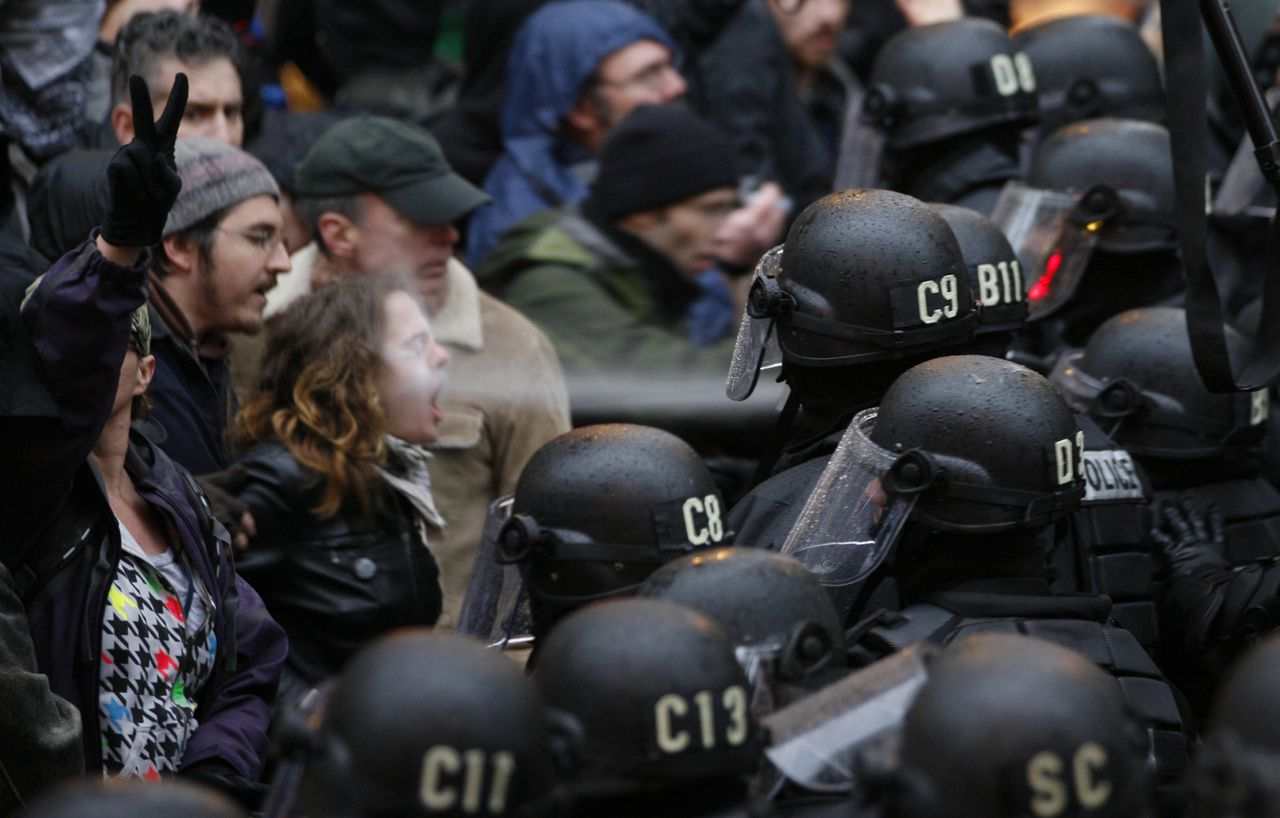 A police officer uses pepper spray on an Occupy Portland protestor at Pioneer Courthouse Square in Portland Ore., Thursday, Nov. 17, 2011. (AP Photo/The Oregonian, Randy L. Rasmussen)