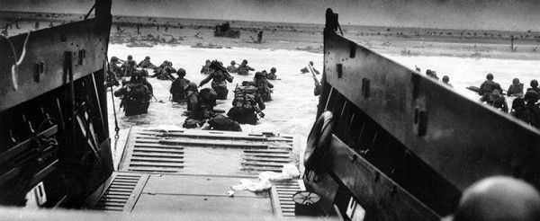 """A still photograph from the series """"The War"""", the new documentary film from Ken Burns and Lynn Novick, shows American soldiers landing on the beach on D-Day in Normandy, France on June 6, 1944. Burns, one of America's greatest visual historians, unveils his most ambitious television project yet on Sunday, a seven-part, 15-hour documentary that tells the story of World War II """"from the bottom up"""". Six years in the making, """"The War"""" explores one of the most devastating episodes in human history from a purely American perspective, as told by dozens of otherwise ordinary men and women who lived through the conflict. REUTERS/U.S. National Archives and Records Administration/PBS/Handout (UNITED STATES). EDITORIAL USE ONLY. NOT FOR SALE FOR MARKETING OR ADVERTISING CAMPAIGNS."""