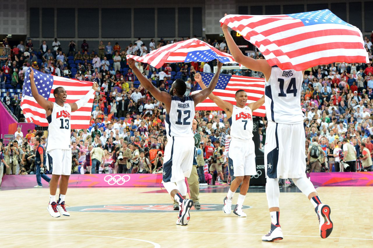 US players celebrate winning 107-100 against Spain during the London 2012 Olympic Games men's gold medal basketball game between USA and Spain at the North Greenwich Arena in London on August 12, 2012. AFP PHOTO /MARK RALSTON