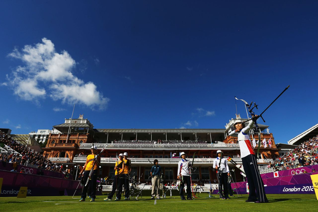 Japan's Ren Hayakawa, right, shoots during the women's team archery competition against Ukraine at the 2012 Summer Olympics, Sunday, July 29, 2012, in London. (AP Photo/Paul Gilham, Pool)