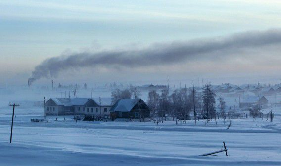 Smoke rises above houses in the village of Maralayi, in the Republic of Sakha, northeast Russia, January 19, 2013. The coldest temperatures in the northern hemisphere have been recorded in Sakha, the location of the Oymyakon valley, where according to the United Kingdom Met Office a temperature of -67.8 degrees Celsius (-90 degrees Fahrenheit) was registered in 1933 - the coldest on record in the northern hemisphere since the beginning of the 20th century. Yet despite the harsh climate, people live in the valley, and the area is equipped with schools, a post office, a bank, and even an airport runway (albeit open only in the summer). Picture taken January 19, 2013. REUTERS/Maxim Shemetov (RUSSIA - Tags: SOCIETY ENVIRONMENT) ATTENTION EDITORS: PICTURE 10 OF 27 FOR PACKAGE 'THE POLE OF COLD' SEARCH 'MAXIM COLD' FOR ALL IMAGES
