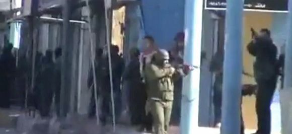 Caption: This image from amateur video made available by the Ugarit News group on Monday, Dec. 12, 2011, purports to show security forces in Daraa, Syria. (AP Photo/Ugarit News Group via APTN) THE ASSOCIATED PRESS CANNOT INDEPENDENTLY VERIFY THE CONTENT, DATE, LOCATION OR AUTHENTICITY OF THIS MATERIAL. TV OUT