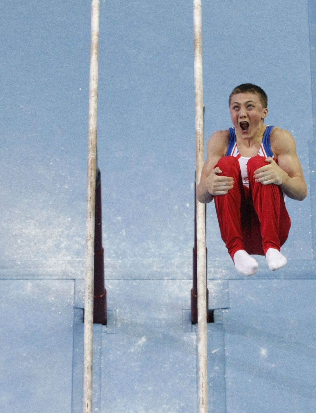 Sam Oldham of Britain performs on the parallel bars during the men's individual all-around final of the artistic gymnastics competition at the Youth Olympic Games (YOG) in Singapore August 18, 2010. REUTERS/Issei Kato (SINGAPORE - Tags: SPORT OLYMPICS GYMNASTICS IMAGES OF THE DAY)