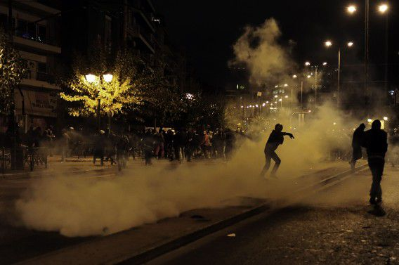 Demonstrators clash with riot police in Athens on November 17, 2011. Tens of thousands of Greeks took to the streets today to protest against austerity measures demanded by the new unity government, clashing briefly with police who responded with tear gas. Police said 27,000 people in Athens and 15,000 in the second city of Thessalonika joined demonstrations marking a 1973 student uprising seen as a key moment in the restoration of democracy in Greece nearly four decades ago. AFP PHOTO / ARIS MESSINIS