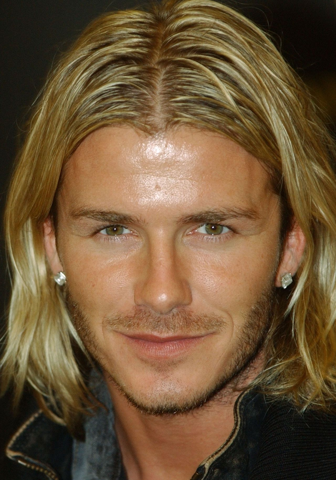 """FILE - In this Nov. 17, 2003 file photo, soccer player David Beckham pauses during a signing session for his autobiography """"My Side"""" held at a London bookstore. Beckham says he is retiring from soccer at the end of the season. The 38-year-old Beckham recently won a league title in a fourth country with Paris Saint-Germain. He has become a global superstar since starting his career at Manchester United. (AP Photo/Richard Lewis, FIle)"""