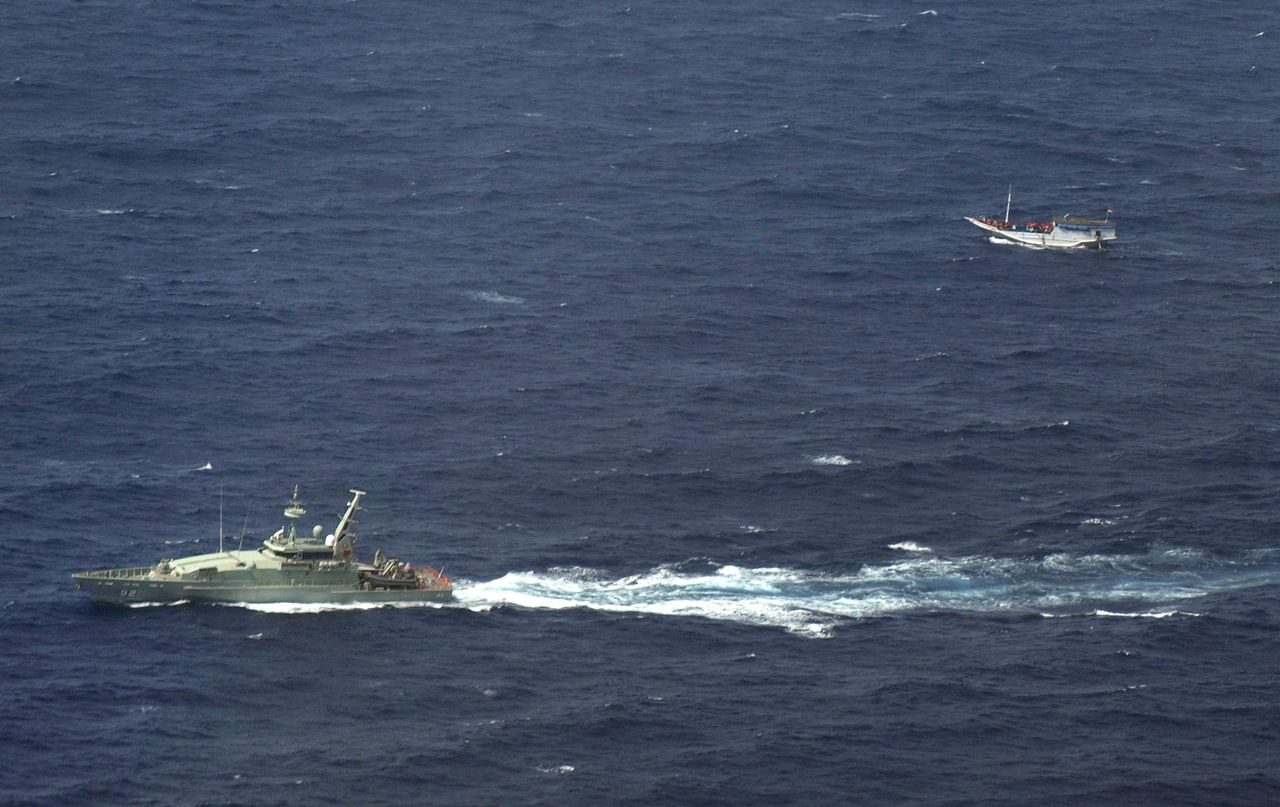 "TO GO WITH Indonesia-Australia-immigration-refugee,FOCUS by Presi Mandari and Angela Dewan (FILES) In this file handout photo released by the Indonesian National Search and Rescue Agency (Basarnas) on July 4, 2012 and taken from an Indonesian Air Force Hercules C-130 aircraft shows an Australian navy boat (L) shadowing a boat (R) believed to be carrying up to 180 asylum-seekers off Indonesia about 50 nautical miles south of Java island and sailing towards Australian waters. Indonesia has failed to assist several boats in trouble near its shores in the past month, with observers saying it has neither the ability nor the inclination to save asylum seekers stranded at sea. AFP PHOTO / FILES / BASARNAS ----EDITORS NOTE ----RESTRICTED TO EDITORIAL USE MANDATORY CREDIT "" AFP PHOTO / BASARNAS"" NO MARKETING NO ADVERTISING CAMPAIGNS - DISTRIBUTED AS A SERVICE TO CLIENTS"
