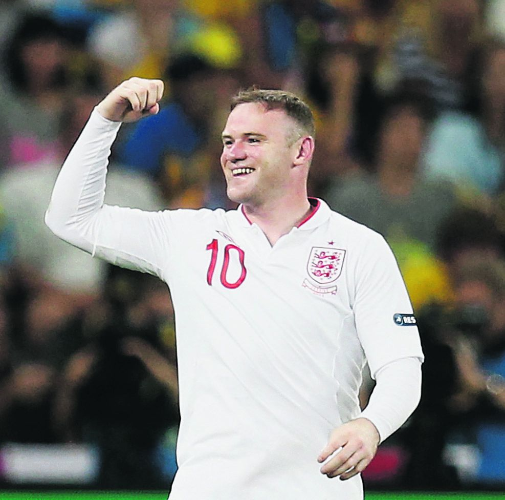 England's Wayne Rooney celebrates after scoring a goal during the Euro 2012 soccer championship Group D match between England and Ukraine in Donetsk, Ukraine, Tuesday, June 19, 2012. (AP Photo/Matthias Schrader)