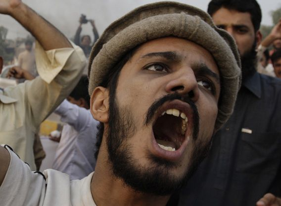 A Pakistani protester shouts anti-American slogans in Lahore, Pakistan on Saturday, Nov. 26, 2011. Pakistan on Saturday accused NATO helicopters and fighter jets of firing on two army checkpoints in the country's northwest and killing 24 soldiers. Islamabad retaliated by closing the border crossings used by the international coalition to supply its troops in neighboring Afghanistan. (AP Photo/K.M.Chaudary)