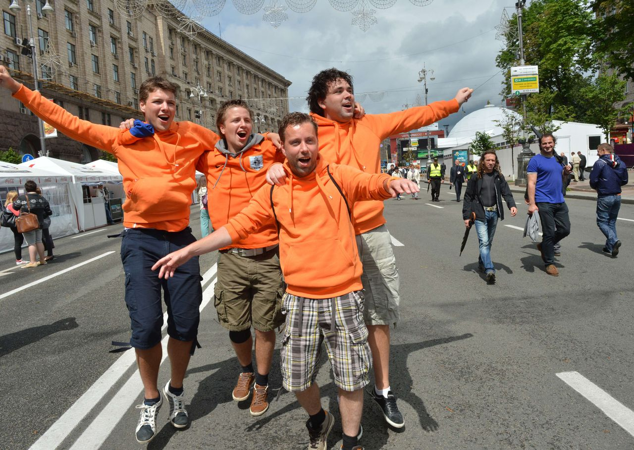 Dutch fans pose in the Euro 2012 fanzone on June 7, 2012 in Kiev on the eve of the Euro 2012 football championships opening match on June 8 in Warsaw. AFP PHOTO/ SERGEI SUPINSKY