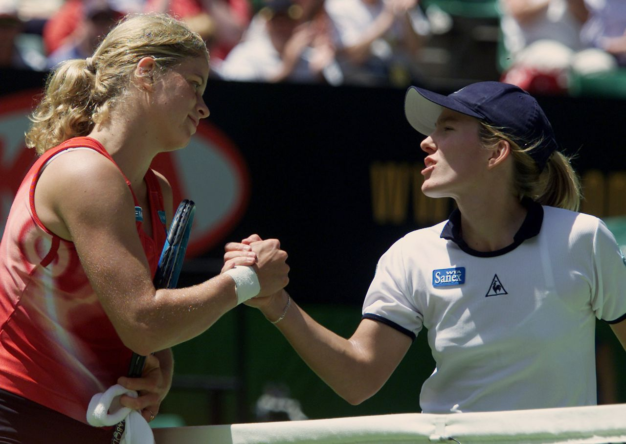 Belgium's Justine Henin (R) congratulates compatriot Kim Clijsters after their quarterfinal match at the Australian Open in Melbourne January 23, 2002. Clijsters won in straight sets 6-2 6-3. REUTERS/Jason Reed MDB/PB