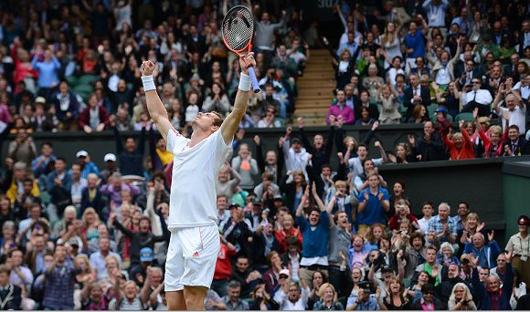Caption: Britain's Andy Murray celebrates his men's singles quarter-final victory over Spain's David Ferrer on day nine of the 2012 Wimbledon Championships tennis tournament at the All England Tennis Club in Wimbledon, southwest London, on July 4, 2012. AFP PHOTO / LEON NEAL RESTRICTED TO EDITORIAL USE