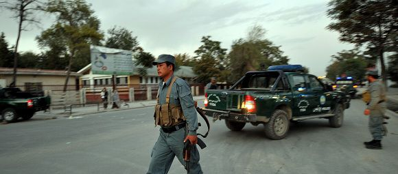 Caption: Afghanistan National Policemen (ANP) block the road near the former president's Rabani house and US embassy after a blast in Kabul on September 20, 2011. A loud explosion rocked Kabul on September 20 close to the US embassy and the home of an Afghan former president who now leads the country's efforts to talk peace with the Taliban, an AFP reporter said. AFP PHOTO / ADEK BERRY