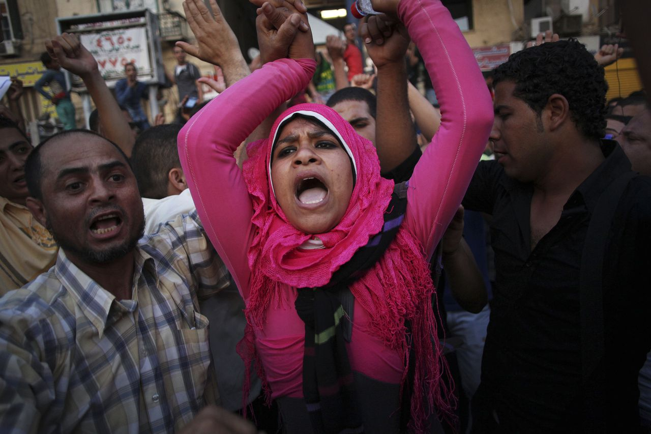Egyptian protesters chant slogans against the country's military ruling council and presidential candidate Ahmed Shafiq in Tahrir Square in Cairo, Egypt, Thursday, June 14, 2012. Judges appointed by Hosni Mubarak dissolved the Islamist-dominated parliament Thursday and ruled that Mubarak's former prime minister can stand in the presidential runoff this weekend — setting the stage for the military and remnants of the old regime to stay in power. (AP Photo/Manu Brabo)