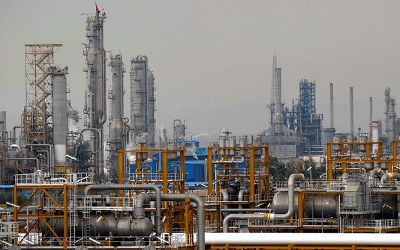 Caption: The Phase 4 and Phase 5 gas refineries are seen in Assalouyeh, 1,000 km (621 miles) south of Tehran in this file photo taken January 27, 2011. The U.S. Senate is set to vote on a tough new round of economic sanctions on Iran's oil sector on Thursday, including measures meant to shut down any financial deals with the country's powerful state oil and tanker enterprises. REUTERS/Caren Firouz/Files (IRAN - Tags: ENERGY BUSINESS)
