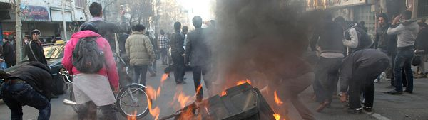 "This photo, taken by an individual not employed by the Associated Press and obtained by the AP outside Iran shows Iranian protestors attending an anti-government protest as a garbage can is set on fire, in Tehran, Iran, Monday, Feb. 14, 2011. Eyewitnesses report that sporadic clashes have erupted in central Tehran's Enghelab or Revolution square between security forces and opposition protesters. The demonstrators were chanting ""death to the dictator,"" referring to the country's hardline president that the opposition believes was reelected through fraud in 2009. (AP Photo)"