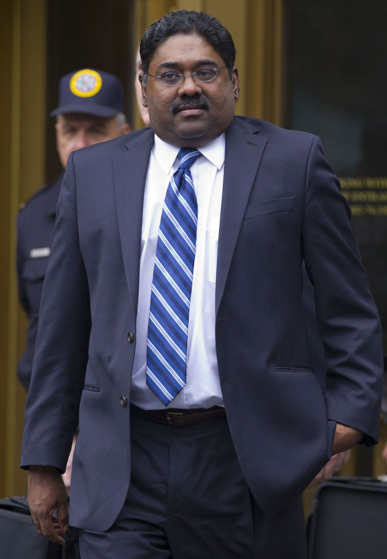Raj Rajaratnam, co-founder of Galleon Group LLC, leaves Federal Court after his sentencing on Thursday, Oct. 13, 2011 in New York. (AP Photo/Jin Lee)