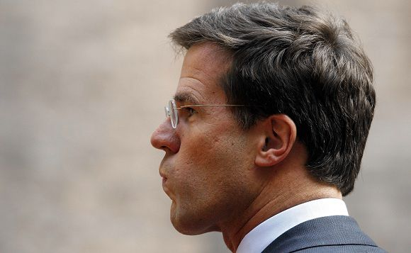 Caption: Netherlands' Prime Minister Mark Rutte waits to welcome Denmark's Prime Minister Helle Thorning-Schmidt at the Binnenhof, seat of Dutch government in The Hague, Netherlands, Thursday, Oct. 27, 2011. (AP Photo/Bas Czerwinski)