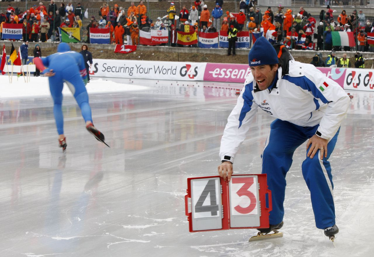 Italy speed skating team coach Gianni Romme, of the Netherlands, during the speed skating men's 5000m event, at the European Speedskating Championships, in Collalbo, Italy, Friday, Jan. 7, 2011. (AP Photo/Antonio Calanni)