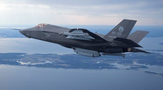 The U.S. Marine Corps version of Lockheed Martin's F35 Joint Strike Fighter, F-35B test aircraft BF-2 flies with external weapons for the first time over the Atlantic test range at Patuxent River Naval Air Systems Command in Maryland in a February 22, 2012 file photo. A decision to start production of Lockheed Martin Corp's F-35 fighter jet before it was fully tested has driven up the $396 billion cost of the troubled project and increased risks, the U.S. general heading development of the warplane has said on February 18, 2013. REUTERS/Lockheed Martin/Handout (UNITED STATES - Tags: MILITARY) ATTENTION EDITORS - THIS IMAGE WAS PROVIDED BY A THIRD PARTY. FOR EDITORIAL USE ONLY. NOT FOR SALE FOR MARKETING OR ADVERTISING CAMPAIGNS. THIS PICTURE IS DISTRIBUTED EXACTLY AS RECEIVED BY REUTERS, AS A SERVICE TO CLIENTS