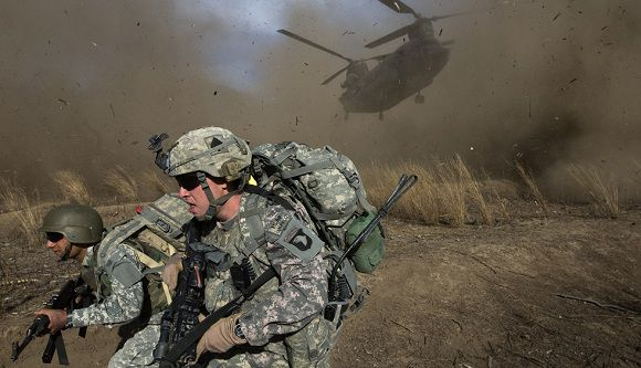 Caption: (FILES) This file photograph taken on November 11, 2009 US Army soldiers from 2-506 Infantry 101st Airborne Division and Afghan National Army soldiers race to get out of the way of a CH-47 Chinook helicopter landing in hostile territory during the launch of Operation Radu Bark VI in the Spira mountains in Khost province, five kms from the Afghan-Pakistan Border, directly across the border from Pakistan's lawless Waziristan region. On August 7, 2011 officials said thirty US troops including special forces died when the Taliban shot down their helicopter in Wardak province southwest of Kabul, late on August 5, in the biggest single loss for foreign troops in the decade-long war. There are currently around 140,000 foreign soldiers in Afghanistan, around 100,000 of them from the US, but all combat forces are due to leave by the end of 2014. AFP PHOTO/DAVID FURST/FILES