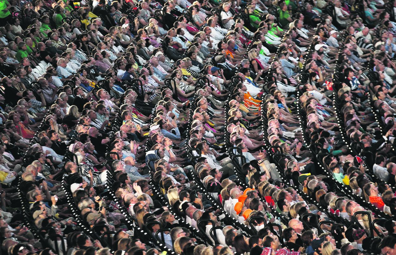 Members of the audience watch a performance during the Opening Ceremony at the 2012 Summer Olympics, Friday, July 27, 2012, in London. (AP Photo/Christophe Ena)