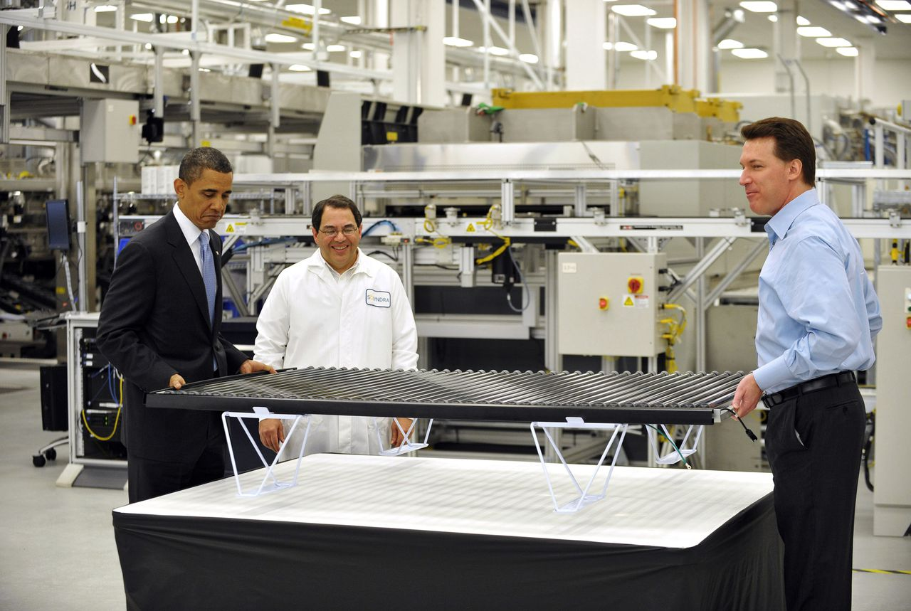 (FILES) US President Barack Obama lifts a solar panel with Chief Executive Officer Chris Gronet (R) as Executive Vice President, Operations and Engineering Ben Bierman looks on during a tour of Solyndra, Inc., a solar panel manufacturing facility, in this May 26, 2010 file photo in Fremont, California. The White House said on September 14, 2011 there was no evidence it has acted inappropriately, after reports said it rushed a review of a half billion dollar loan to now bankrupt solar panel firm Solyndra, leaving taxpayers on the hook for a 535 million dollar USD loan. AFP PHOTO/Mandel NGAN/FILES