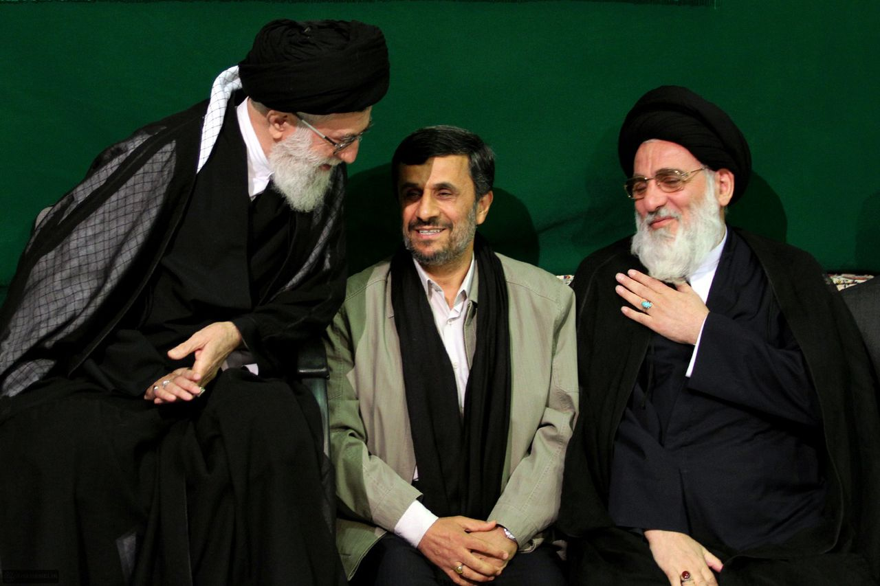 """EDS NOTE-RESTRICTED TO EDITORIAL USE - MANDATORY CREDIT """"AFP PHOTO / HO / Iranian Supreme Leader's Website"""" - NO MARKETING NO ADVERTISING CAMPAIGNS - DISTRIBUTED AS A SERVICE TO CLIENTS-- In this photo released by the official website of the Iranian supreme leader's office on May 9, 2011, Iranian supreme leader Ayatollah Ali Khamenei (L) greets Iranian former judiciary chief Mahmoud Hashemi Shahrudi (R) as Iran's President Mahmoud Ahmadinejad (C) looks on during a religious ceremony to commemorate the death anniversary of Fatima, daughter of Prophet Mohammad, on May 7, 2011, in Tehran. AFP PHOTO/HO"""