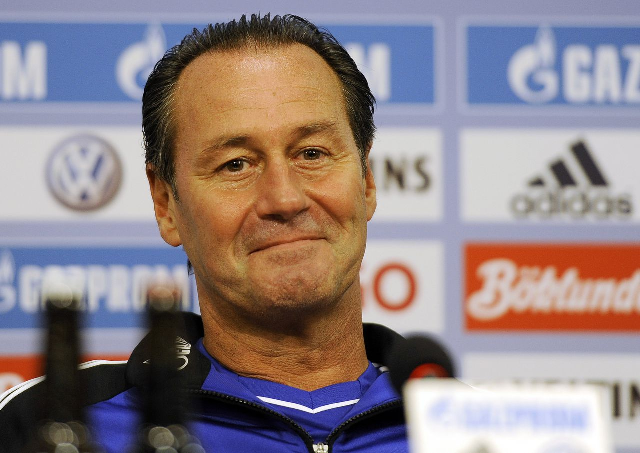 New head coach of Bundesliga soccer club FC Schalke 04 Huub Stevens from the Netherlands smiles during a press conference in Gelsenkirchen, Germany, Tuesday, Sept. 27, 2011. Stevens follows former head coach Ralf Rangnick, who resigned last week because of suffering a burnout syndrome. Stevens, 57, previously coached Schalke from 1996 to 2002, becoming the club's longest-serving coach. He led the club to the UEFA Cup title in 1997, the German Cup in 2001 and 2002, and came agonizingly close to winning the league in 2001 when Bayern Munich snatched the title. (AP Photo/Martin Meissner)