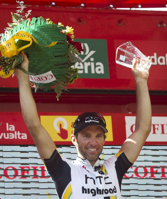 Switzerland's Michael Albasini of HCT Highroad team celebrates on the podium after winning the 13th stage of the Tour of Spain, a 158,2km stage ride from Sarria to Ponferrada, on September 2, 2011. AFP PHOTO / Jaime REINA