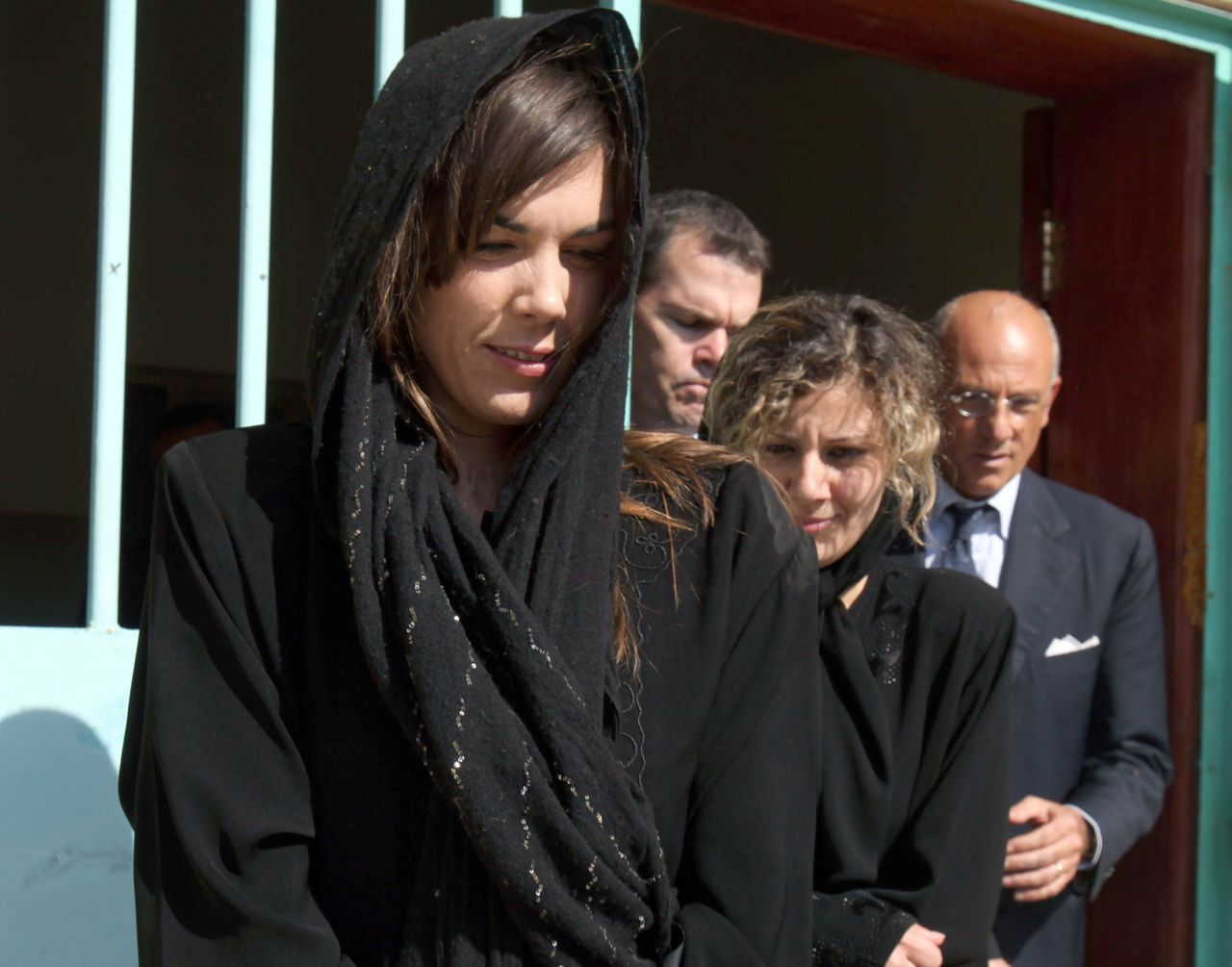 Australian lawyer Melinda Taylor (L) and her interpreter from Lebanon, Helen Assaf (C), who were part of a legal team from the International Criminal Court, detained on June 7, after visiting Seif al-Islam Kadhafi, a son of slain dictator Moamer Kadhafi, are seen following their release from detention in Zintan, a town southwest of Tripoli, on July 2, 2012. Taylor, Assaf, and two colleagues, Russian Alexander Khodakov and Esteban Peralta Losilla from Spain, were released by a brigade holding Seif al-Islam Kadhafi, after Taylor was accused of carrying a pen camera and attempting to give Seif al-Islam a coded letter from his former right-hand man, Mohammed Ismail, who is wanted by the Libyan authorities. AFP PHOTO/MAHMUD TURKIA