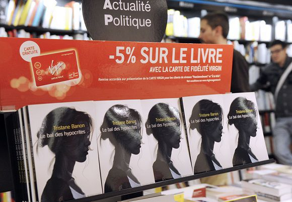 """Caption: French writer Tristane Banon's """"Le Bal des Hypocrites"""" (The Hypocrites' Ball) books are displayed in a multimedia store in Paris on October 13, 2011. Banon has accused former IMF chief Dominique Strauss-Kahn of trying to rape her in 2003 in an unfurnished Paris flat and the 126-page book is a novelisation of her role in the Strauss-Kahn scandal after a hotel maid accused last May Strauss-Kahn of sexual assault and attempted rape in his suite at the Sofitel in New York. AFP PHOTO MICHEL GANGNE"""