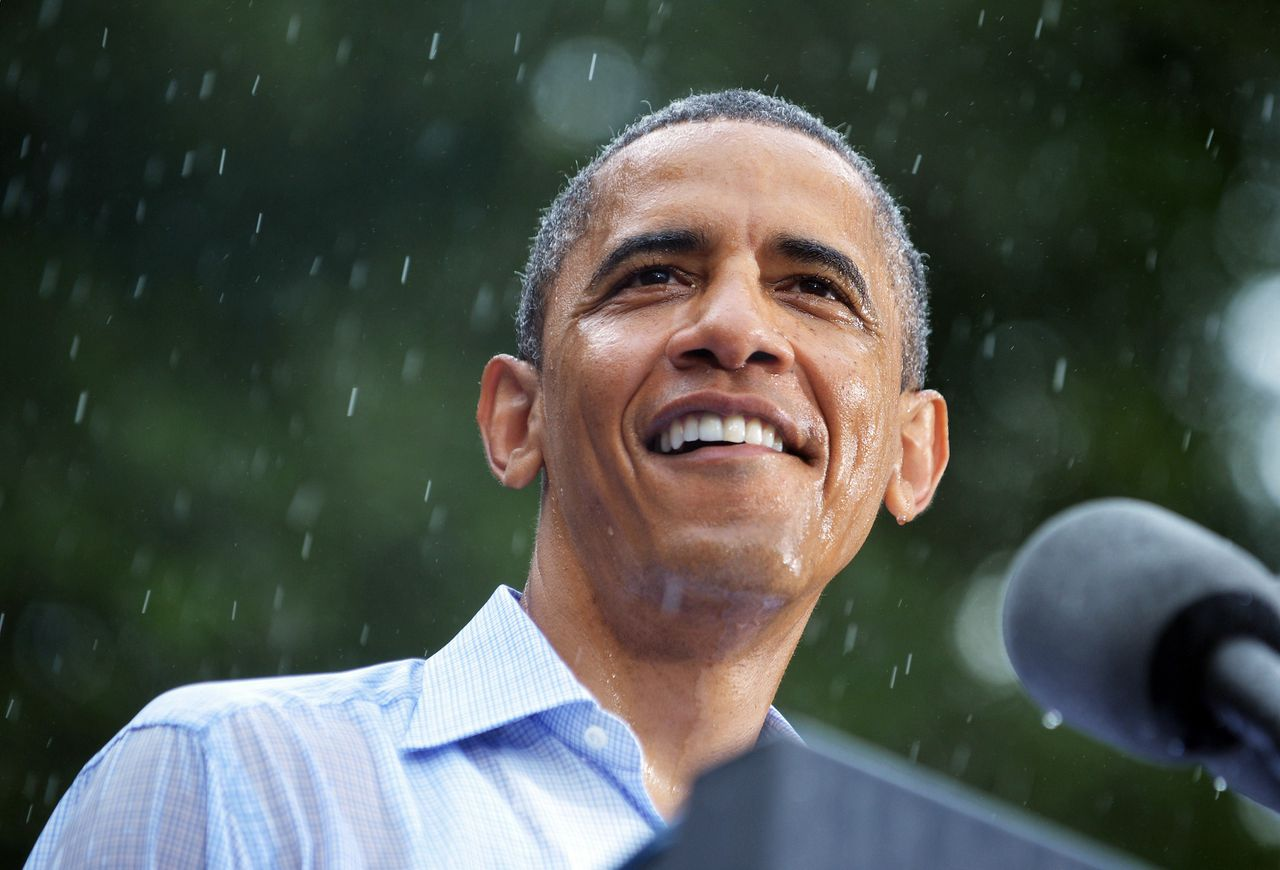 "(FILES)US President Barack Obama speaks during a rain-soaked campaign event July 14, 2012 at Walkerton Tavern & Gardens in Glen Allen, Virginia. Forsaking his annual vacation in Martha's Vineyard to campaign for re-election, US President Barack Obama has admitted to a bit of holiday blues as his daughters head off to summer camp. Obama said he was going to spend most of the summer campaigning ahead of the November 6 election and to make matters worse his daughters Malia, 14, and Sasha, 11, were soon going to be flying the White House nest. ""So they've got a sleep-away camp for a month, both of them are leaving,"" the president said in an interview with CBS television airing July 15. 2012. ""We're going to be, you know, experiencing the first stages of empty nest syndrome.""AFP PHOTO/Mandel NGAN/FILES"