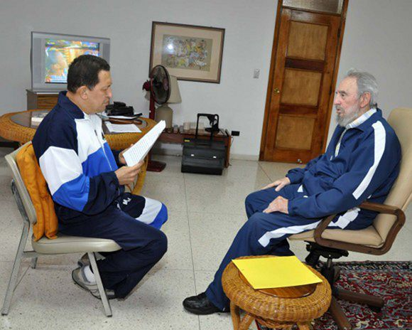 A handout photo shows former Cuban leader Fidel Castro looking on as Venezuela's President Hugo Chavez reads a document in Havana July 3, 2011. Venezuela's socialist leader Chavez is being treated in Cuba after surgery to remove a cancerous tumor. The announcement has rocked the OPEC nation and changed the political dynamics ahead of a 2012 election. REUTERS/Revolution Studios/Cubadebate/Handout (CUBA - Tags: POLITICS HEALTH) FOR EDITORIAL USE ONLY. NOT FOR SALE FOR MARKETING OR ADVERTISING CAMPAIGNS. THIS IMAGE HAS BEEN SUPPLIED BY A THIRD PARTY. IT IS DISTRIBUTED, EXACTLY AS RECEIVED BY REUTERS, AS A SERVICE TO CLIENTS. QUALITY FROM SOURCE