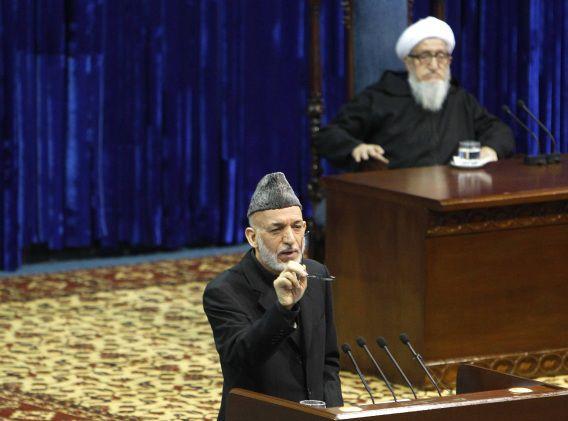 De Afghaanse president Karzai, gisteren tijdens een ontmoeting met de loya jirga.