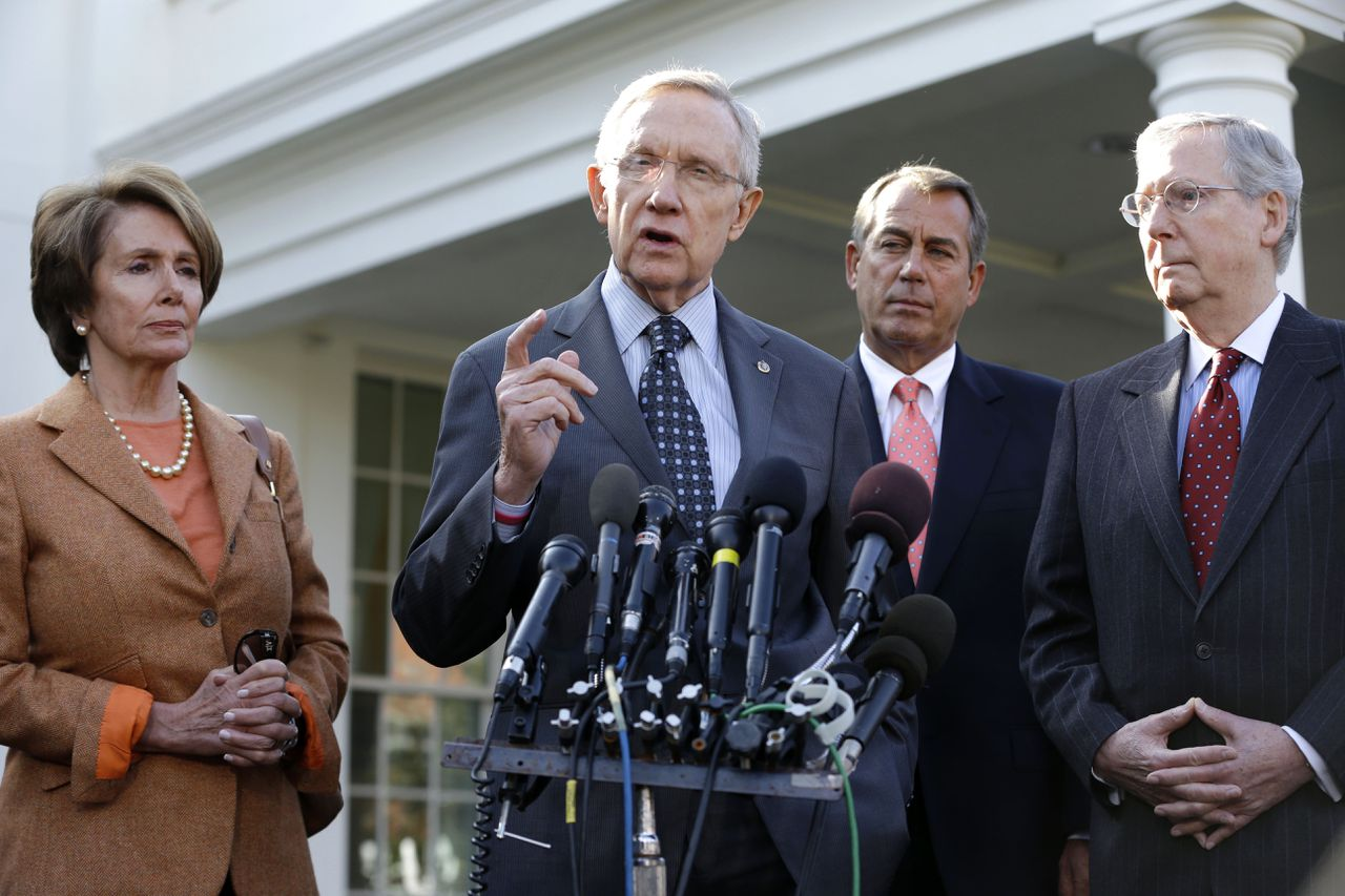 Senate Majority Leader Harry Reid of Nev., second from left, accompanied by, from left, House Minority Leader Nancy Pelosi of Calif., House Speaker John Boehner of Ohio and Senate Minority Leader Mitch McConnell of Ky., gestures as he speaks to reporters outside the White House in Washington, Friday, Nov. 16, 2012, following a meeting with President Barack Obama to discuss the economy and the deficit. (AP Photo/Jacquelyn Martin)