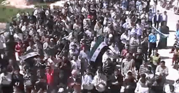 Caption: In this image made from amateur video released by the Shaam News Network and accessed Thursday, April 12, 2012, purports to show Syrians chanting slogans during a demonstration in Idlib, Syria. Syrian forces halted attacks on opposition strongholds Thursday in line with a U.N.-brokered truce but the regime defied demands by international envoy Kofi Annan to pull troops back to their barracks, activists said. (AP Photo/Shaam News Network via AP video) TV OUT, THE ASSOCIATED PRESS CANNOT INDEPENDENTLY VERIFY THE CONTENT, DATE, LOCATION OR AUTHENTICITY OF THIS MATERIAL