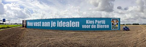 Dutch election sign, saying Hold on to your ideals, vote Party for the Animals, photo by Hollandse Hoogte / Thomas Schlijper