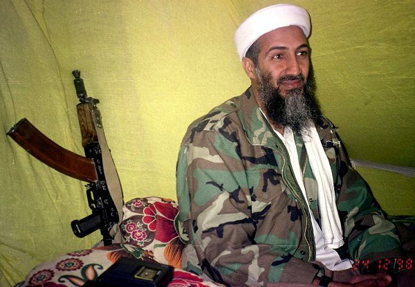 FILE - In this Dec. 24, 1998 file photo, al-Qaida leader Osama Bin Laden speaks to a selected group of reporters in the mountains of Helmand Province in southern Afghanistan. Foreign and Pakistani analysts, former operatives of Pakistan's Inter-Services Intelligence agency and military men interviewed by The Associated Press say that some ISI agents, local police and local officials most likely did know about bin Laden's hideout in Abbottabad, Pakistan. The question is, at what level, and how close to the top? (AP Photo/Rahimullah Yousafzai, File)
