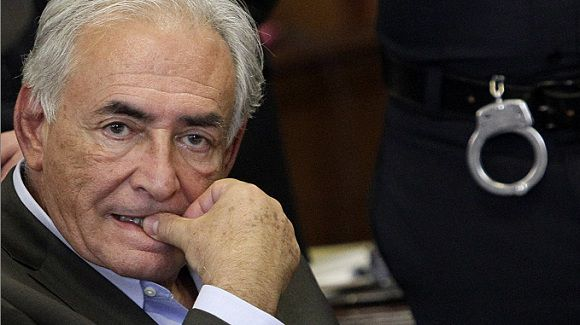 Caption: (FILES) In this dated May 19, 2011 filed photo shows former IMF head Dominique Strauss-Kahn sits during his bail hearing at State Supreme Court, in New York. Former IMF chief Dominique Strauss-Kahn was seen entering an elevator at 1:20 am with an unknown woman the night before he allegedly tried to rape a hotel maid, the New York Times reported on July 8, 2011. It cited a law enforcement official as saying that video cameras picked up the two of them boarding the elevator. The official told the Times the woman was identified and located but declined to speak with investigators. The Times also reported that two hotel workers told investigators that Strauss-Kahn had invited them to his suite the same night, and that they had separately declined. AFP PHOTO / POOL / Richard Drew