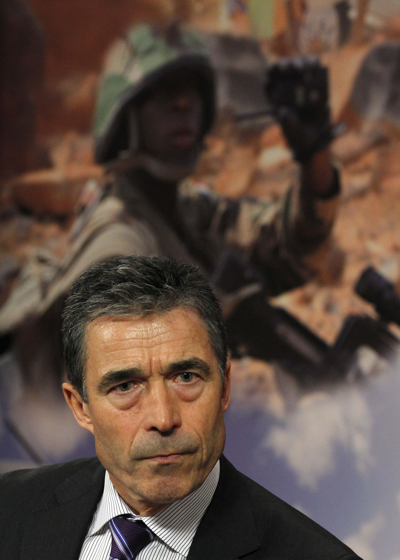 NATO Secretary-General Anders Fogh Rasmussen briefs the media during a NATO defence ministers meeting at the Alliance headquarters in Brussels June 8, 2011. NATO sought broader support for the Western bombing campaign in Libya on Wednesday with alliance air power stretched by the heaviest strikes on Tripoli so far. REUTERS/Yves Herman (BELGIUM - Tags: POLITICS MILITARY CONFLICT HEADSHOT)