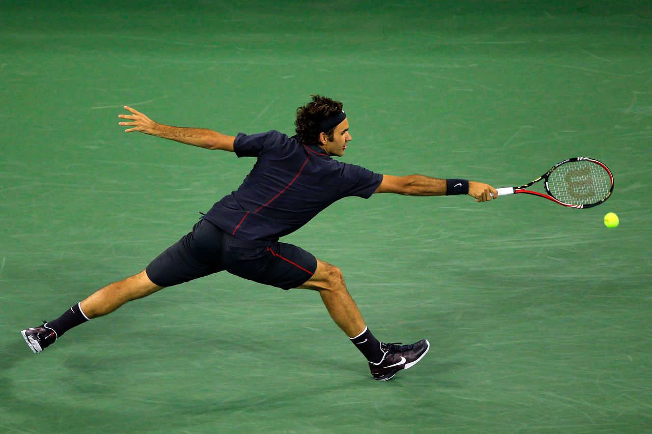 NEW YORK, NY - SEPTEMBER 05: Roger Federer of Switzerland hits a backhand against Juan Monaco of Argentina during Day Eight of the 2011 US Open at the USTA Billie Jean King National Tennis Center on September 5, 2011 in the Flushing neighborhood of the Queens borough of New York City. Chris Trotman/Getty Images/AFP == FOR NEWSPAPERS, INTERNET, TELCOS & TELEVISION USE ONLY ==