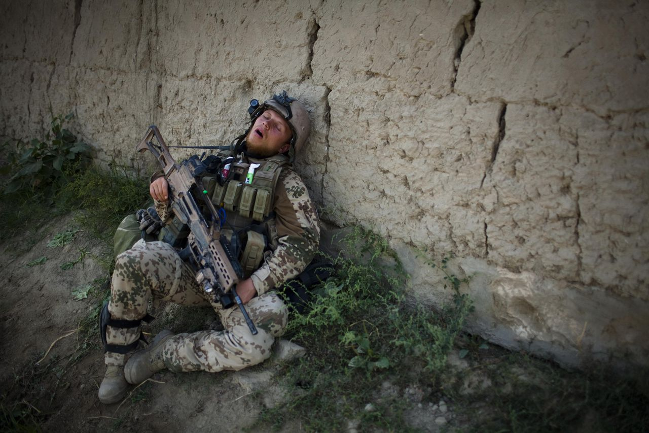 A German soldier rests during a break while on long term patrol near Char Darah, outside Kunduz, Afghanistan, Monday, Sept. 19, 2011. (AP Photo/Anja Niedringhaus)