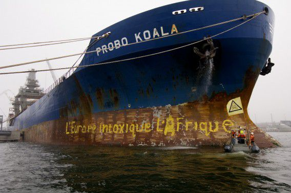 In this photo released by Greenpeace, activists of Greenpeace paint a slogan on the cargo vessel Probo Koala in the harbour of Paldiski Port, Estonia, Tuesday, Sept. 26, 2006, on the second day of the Greenpeace blockade of the ship. Estonia, which joined the EU in 2004 is holding the tanker linked to a toxic waste discharge in Ivory Coast. Ivory Coast officials claim eight people died from exposure to waste shipped by the tanker and dumped last month in the commercial capital of Abidjan. The company that chartered the ship, however, said its cargo consisted of material with little toxicity at most. Ivory Coast and Greenpeace activists forced Estonia to impound the ship. (AP Photo/ Christian Aslund/ Greenpeace/ HO ) GREENPEACE HANDOUT, NO ARCHIVE, NO RESALE, CREDIT LINE COMPULSORY