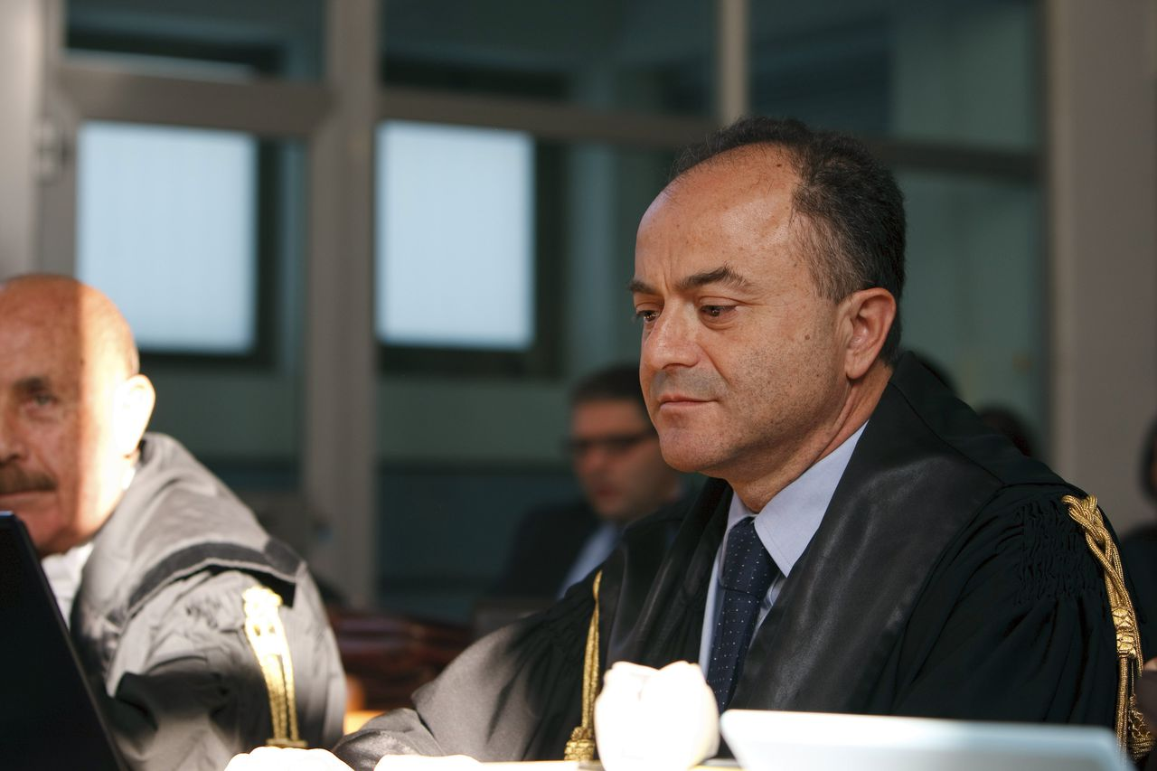 Reggio Calabria's District Attorney Nicola Gratteri attends the opening session of the trial of fourteen people judged for crimes related to a bloody vendetta between the Vottari-Pelle and Strangio-Nirta clans of the 'Ndrangheta mafia that led to a massacre last year in Duisburg, Germany, on November 12, 2008 at a court in Locri, Calabria. Three of them, including the main suspect in the Duisburg slayings, are at large and being tried in absentia. AFP PHOTO / ANTONIO TACCONE