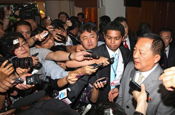 Members of the media surround North Korea's new nuclear envoy Ri Yong-Ho (R) after his meeting with his South Korean counterpart Wi Sung-Lac (not pictured) at a hotel in Nusa Dua on the Indonesian resort island of Bali on July 22, 2011 on the sidelines of the Association of Southeast Asian Nations (ASEAN) ministers' meetings. The meeting on the sidelines of the Asia security forum was the first-ever North-South contact on nuclear issues outside six-nation negotiations on the North's atomic weaponry. REPUBLIC OF KOREA OUT NO ARCHIVES NO INTERNET RESTRICTED TO SUBSCRIPTION USE AFP PHOTO/YONHAP