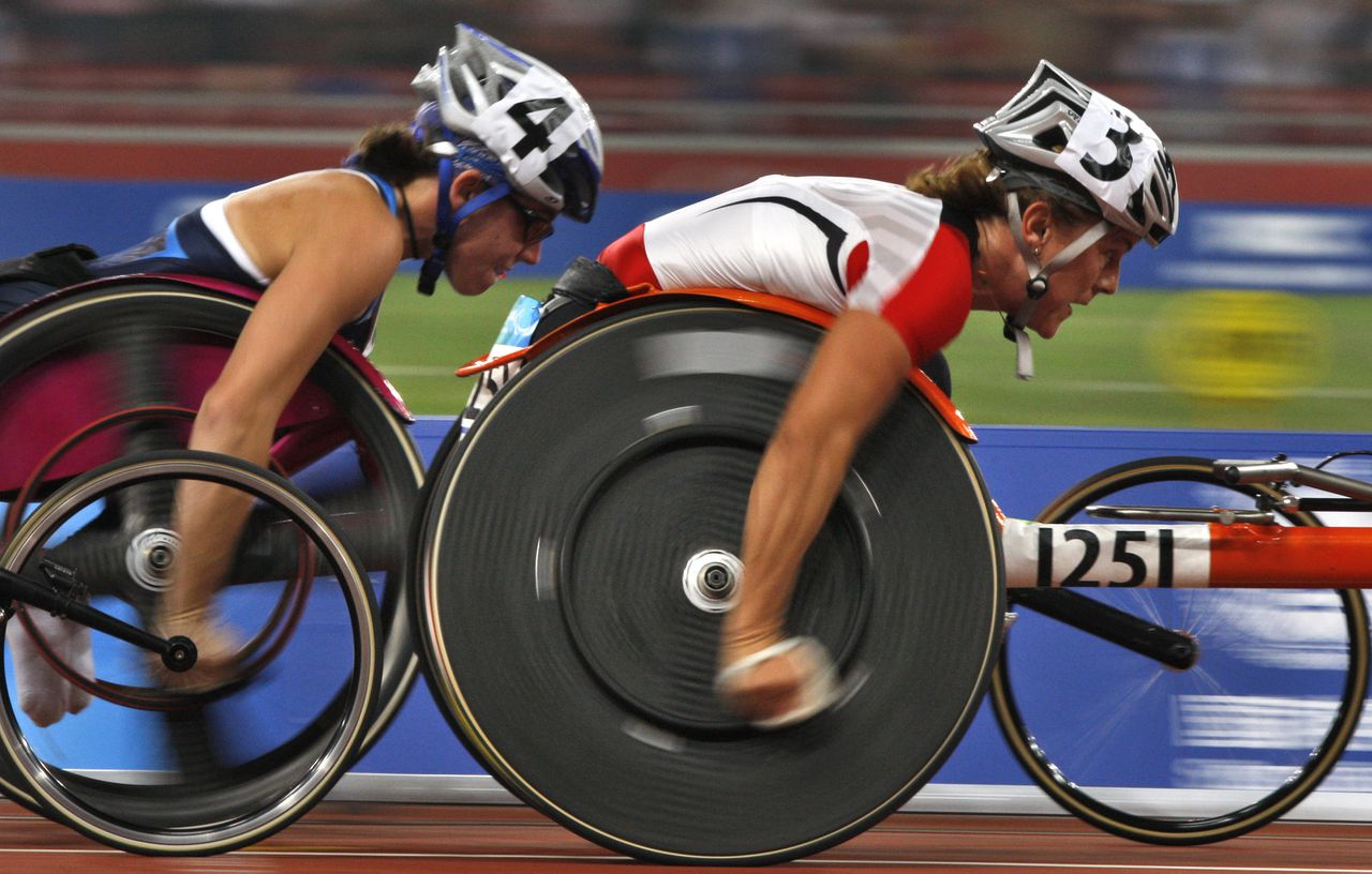 Canada's Diane Roy, right and United State's Amanda McGrory, left racce int the Women's 5000m T54 competition in the Beijing 2008 Paralympic Games held in Beijing, China, Monday, Sept. 8, 2008. Roy took gold with a time of 11 mins 54.03 seconds while McGrory settle for bronze with 11 mins 54.84 seconds.(AP Photo/Ng Han Guan)