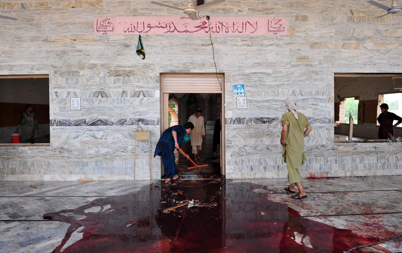 GRAPHIC CONTENT Local residents clean a mosque after a suicide bomb attack in the town of Jamrud, 25 kilometres (16 miles) from Peshawar on August 19, 2011. A suicide bomber hit a Pakistani mosque during Friday prayers, killing at least 43 people and wounding more than 100 others in the tribal district of Khyber, officials said. The Khyber bomb exploded after more than 500 people had packed into the mosque in the town of Jamrud, 25 kilometres (16 miles) from Peshawar, the main city in the northwest where most of the violence in Pakistan is concentrated. AFP PHOTO / A. MAJEED