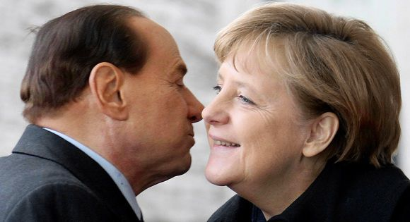 Caption: File picture shows German Chancellor Angela Merkel welcoming Italian Prime Minister Silvio Berlusconi upon his arrival at the Chancellery in Berlin January 12, 2011. Media outlets and social network sites are warning that Italy's scandal-plagued prime minister Silvio Berlusconi could risk causing fresh offence if reports about an unpleasant comment made about Germany's Chancellor Angela Merkel turn out to be true. Picture taken January 12, 2011. REUTERS/Fabrizio Bensch/File (GERMANY - Tags: POLITICS)