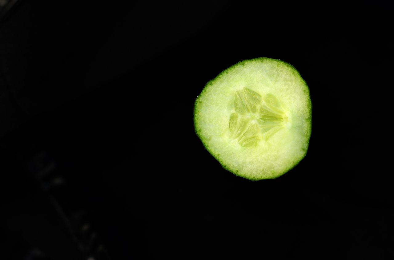 ILLUSTRATION - A slice of a German cucumber is pictured on 30 May, 2011 in Leipzig, eastern Germany. Germany called crisis talks over warnings that an outbreak of E. coli bacteria poisoning, which is believed to have already left 11 dead, was still spreading. Some two weeks after the outbreak was first reported in the north of the country, the number of people contaminated or suspected of having been poisoned by the potentially deadly enterohaemorrhagic E. coli (EHEC) has reached 1,200, according to media reports. Authorities had earlier said they had traced some bacteria on organic cucumbers imported from Spain, a measure which led many supermarkets and shops to remove all Spanish-grown vegetables from their shelves. AFP / JOHANNES EISELE
